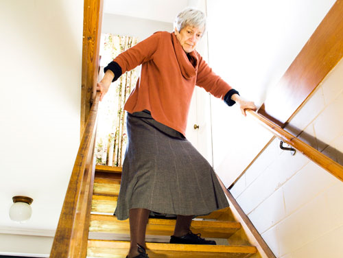 Elderly Woman Walking Downstairs